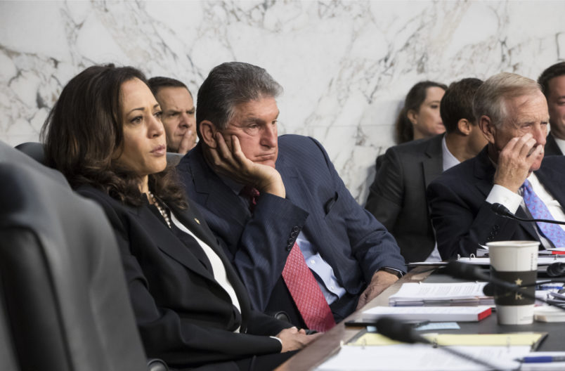 Senate Intelligence Committee members, from left, Sen. Kamala Harris, D-Calif., Sen. Joe Manchin, D-W.Va., and Sen. Angus King, D-Maine, listen to testimony from Director of National Intelligence Dan Coats and other security chiefs about gathering intelligence on foreign agents, on Capitol Hill in Washington, Wednesday, June 7, 2017. (AP Photo/J. Scott Applewhite)