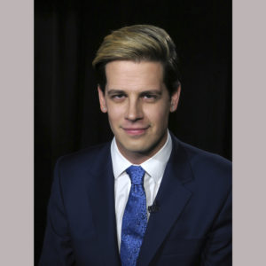 Media personality and author Milo Yiannopoulos appears during an interview in New York on Tuesday, July 18, 2017. (AP Photo/John Carucci)