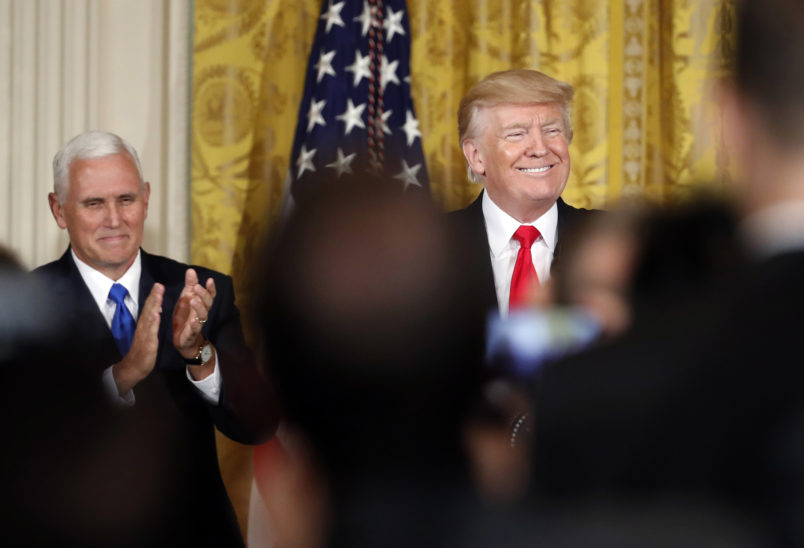 President Donald Trump, accompanied by Vice President Mike Pence, smiles before speaking in the East Room of the White House, Wednesday, July 26, 2017, in Washington. Trump is announcing the first U.S. assembly plant for electronics giant Foxconn in a project that's expected to result in billions of dollars in investment in the state and create thousands of jobs. (AP Photo/Alex Brandon)