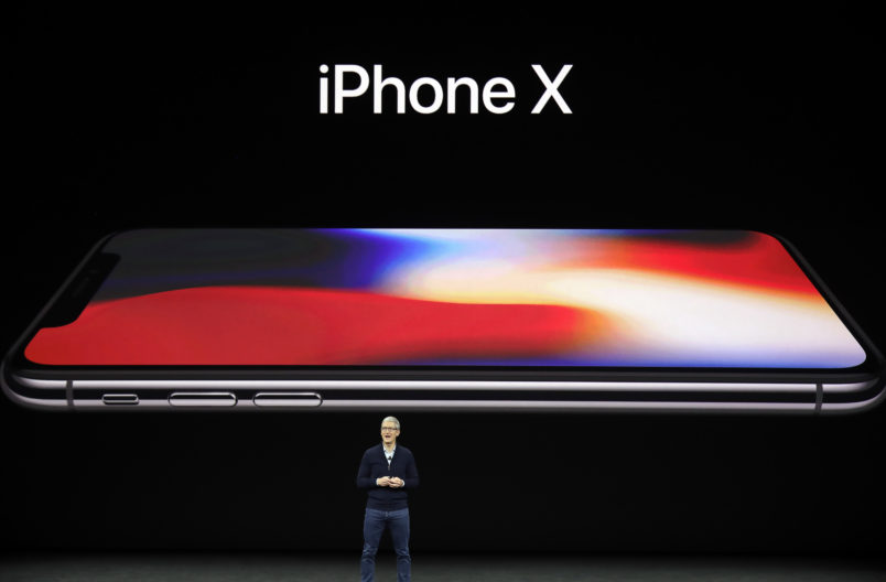 Apple CEO Tim Cook, announces the new iPhone X at the Steve Jobs Theater on the new Apple campus on Tuesday, Sept. 12, 2017, in Cupertino, Calif. (AP Photo/Marcio Jose Sanchez)