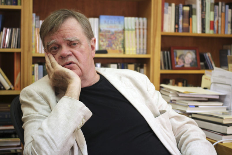 "In this July 26, 2017 photo, ""A Prairie Home Companion"" creator and former host Garrison Keillor talks at his St. Paul, Minn., office. Keillor is not spending his time in retirement baking Powdermilk Biscuits or drinking coffee down at the Chatterbox Cafe now that he has hung up his microphone as host of his popular public radio show ""A Prairie Home Companion."" He turns 75 on Aug. 7 and boards a bus the next day for a 28-city ""Prairie Home Love & Comedy Tour _ 2017,"" which he vows will be his last. (AP Photo/Jeff Baenen)"