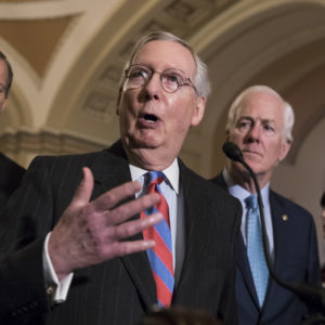 With the deadline looming to pass a spending bill to fund the government by week's end, Senate Majority Leader Mitch McConnell, R-Ky., joined by, from left, Sen. Roy Blunt, R-Mo., Sen. John Thune, R-S.D., and Majority Whip John Cornyn, R-Texas, meets reporters following a closed-door strategy session, on Capitol Hill in Washington, Tuesday, Dec. 5, 2017.  (AP Photo/J. Scott Applewhite)