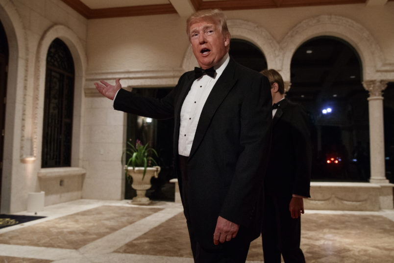 President Donald Trump speaks with reporters as he arrives for a New Year's Eve gala at his Mar-a-Lago resort, Sunday, Dec. 31, 2017, in Palm Beach, Fla. (AP Photo/Evan Vucci)