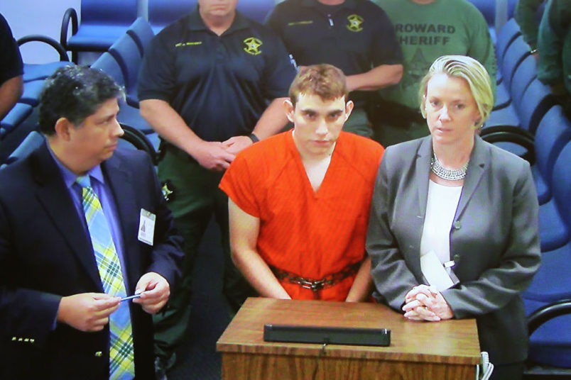Nikolas Cruz, 19, a former student at Marjory Stoneman Douglas High School in Parkland, Florida, where he allegedly killed 17 people, is seen on a closed circuit television screen during a bond  hearing in front of Broward Judge Kim Mollica at the Broward County Courthouse on February 15, 2018 in Fort Lauderdale, Florida. Mr. Cruz is possibly facing 17 counts of premeditated murder in the school shooting.