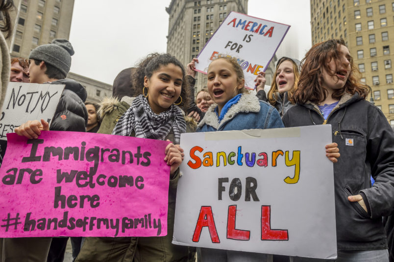 "FOLEY SQUARE, NEW YORK, NY, UNITED STATES - 2017/02/07: High School and College students from across New York City walked out of classes at noon and congregated at Foley Square, united in opposition to the recent illegal executive order targeting Muslims and refugees, also known as the ""Muslim Ban."". (Photo by Erik Mcgregor/Pacific Press/LightRocket via Getty Images)"