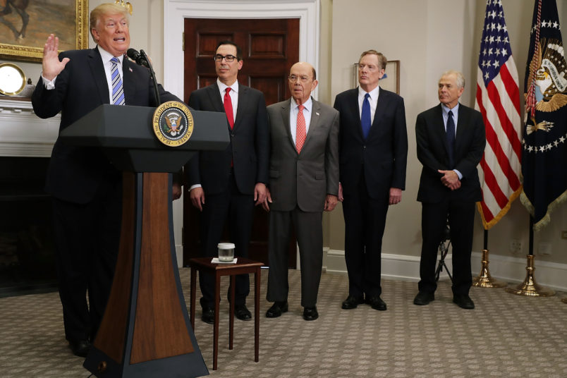 U.S. President Donald Trump signs the 'Section 232 Proclamations' on steel and aluinum imports in Roosevelt Room the the White House March 8, 2018 in Washington, DC. Trump announced a week earlier that he will put a 25-percent tarriff on steel and a 10-percent tarriff on alumninum.