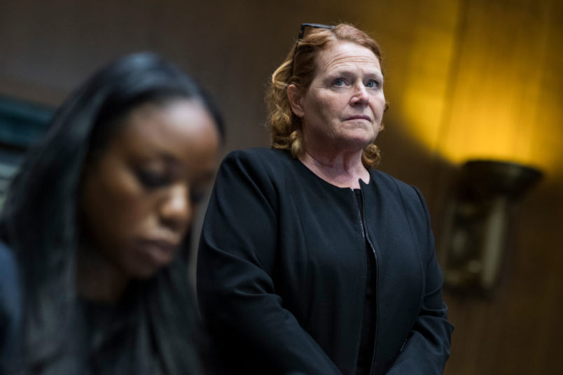"UNITED STATES - JUNE 5: Sen. Heidi Heitkamp, D-N.D., right, and Dr. Nadine Burke Harris, founder and CEO of the Center for Youth Wellness, attend a briefing in Dirksen Building on ""substance use and childhood trauma,"" on June 5, 2018. (Photo By Tom Williams/CQ Roll Call)"