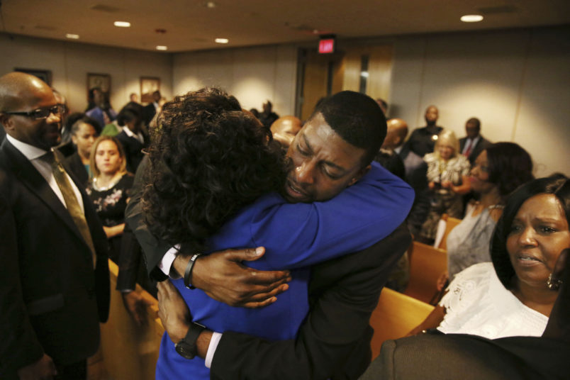 Odell Edwards, father of Jordan Edwards, gets a hug from Dallas County district attorney Faith Johnson after hearing a guilty of murder verdict during the ninth day of the trial of fired Balch Springs police officer Roy Oliver, who was charged with the murder of 15-year-old Jordan Edwards, at the Frank Crowley Courts Building in Dallas on Tuesday, Aug. 28, 2018. (Rose Baca - Pool/The Dallas Morning News) ORG XMIT: DMN1808281444083805