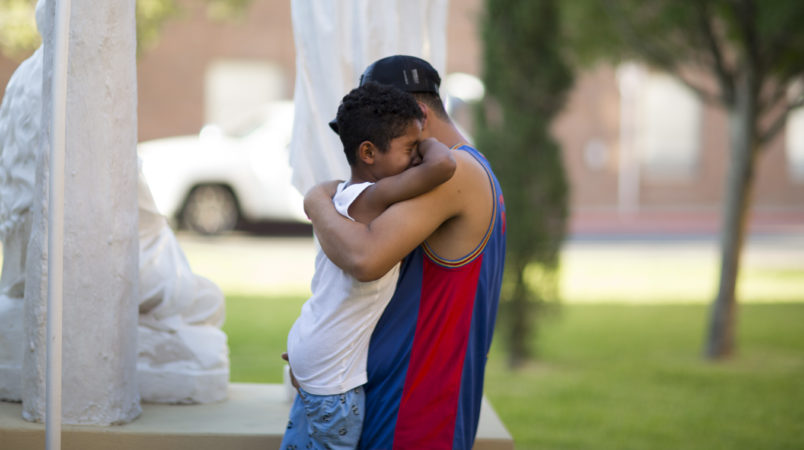 EL PASO, TX July 20: Ariel Romero and his son Jose Romero, 7, of Honduras cry outside of the Loretto-Nazareth Migrant Shelter in El Paso, Texas on July 20, 2018. (Photo by Ivan Pierre Aguirre/ For The Washington Post)