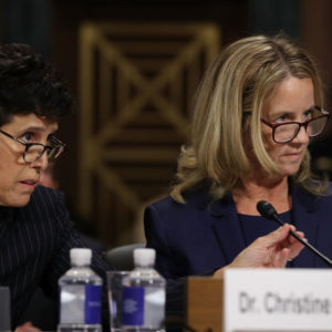 WASHINGTON, DC - SEPTEMBER 27:  Attorney Debra Katz (L) helps her client Christine Blasey Ford as she testifies before the Senate Judiciary Committee in the Dirksen Senate Office Building on Capitol Hill September 27, 2018 in Washington, DC. A professor at Palo Alto University and a research psychologist at the Stanford University School of Medicine, Ford has accused Supreme Court nominee Judge Brett Kavanaugh of sexually assaulting her during a party in 1982 when they were high school students in suburban Maryland.  (Photo by Win McNamee/Getty Images)