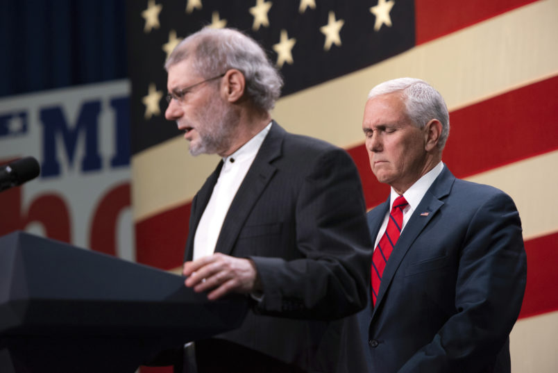 Vice President Mike Pence prays with a Rabbi Loren Jacobs, of Bloomfield Hills' Congregation Shema Yisrael, for the victims and families of those killed in the Pittsburgh synagogue shooting at a rally for Republicans in Oakland County Monday at the Oakland County Airport in Waterford, Oct. 29, 2018. (Tanya Moutzalias | MLive.com) Tanya Moutzalias | MLive.com