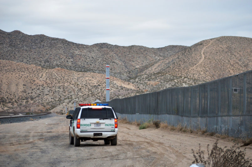 In this Jan. 4, 2016 photo, a U.S. Border Patrol agent patrols Sunland Park along the U.S.-Mexico border next to Ciudad Juarez. The New Mexico border town, next to El Paso, Texas, has struggled to put a series of national scandals behind it until two city councilors were recently arrested. (AP Photo/Russell Contreras)