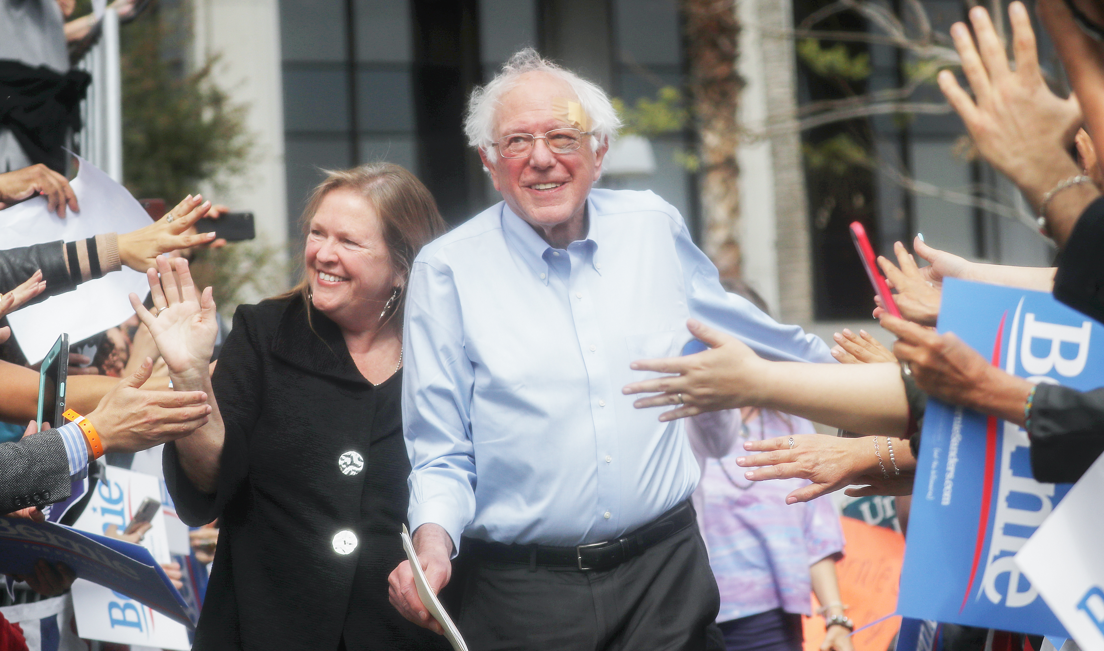 LOS ANGELES, CALIFORNIA - MARCH 23: 2020 Democratic presidential candidate U.S. Sen. Bernie Sanders (I-VT), C, arrives with his wife Jane at a campaign rally in Grand Park on March 23, 2019 in Los Angeles, California. Sanders, who is so far the top Democratic candidate in the race, is making the rounds in California which is considered a crucial 'first five' primary state by the Sanders campaign. California will hold on early primary on March 3, 2020. (Photo by Mario Tama/Getty Images)