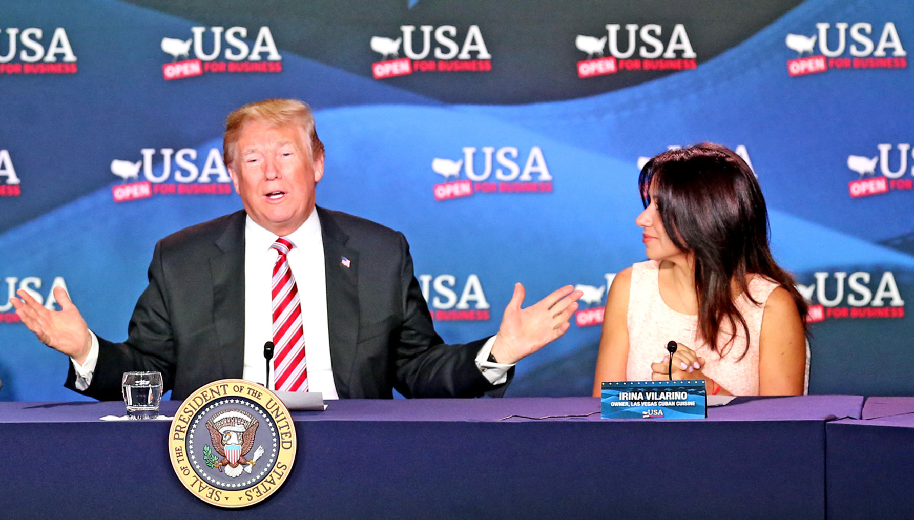 U.S. President Donald Trump, flanked by Maximo Alvarez and Irina Vilarino, talks at a Roundtable Discussion on Tax Reform on Monday, April 16, 2018 at Bucky Dent Park in Hialeah, Fla. (Charles Trainor Jr./Miami Herald/TNS)