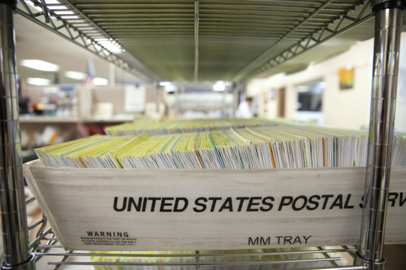 MODESTO, CA - NOVEMBER 06: Mailed in ballots sit in US Postal Service bins inside the office of the Stanislaus County Clerk on November 6, 2018 in Modesto, California. Stanislaus County is in California's 10th Congressional District which is host to a close race for US Congress between Democrat Josh Harder and Republican Jeff Denham. (Photo by Alex Edelman/Getty Images)