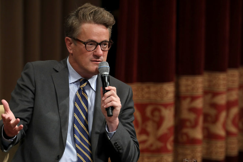 MSNBC 'Morning Joe' hosts Joe Scarborough and Mika Brzezinski are interviewed by philanthropist and financier David Rubenstein during a Harvard Kennedy School Institute of Politics event in the McGowan Theater at the National Archives July 12, 2017 in Washington, DC. Scarborough and Brzezinski, who are engaged to be married, were recently attacked by President Donald Trump on Twitter, where he called the hosts 'Psycho Joe' and 'low I.Q. Crazy Mika,' among other personal insults.