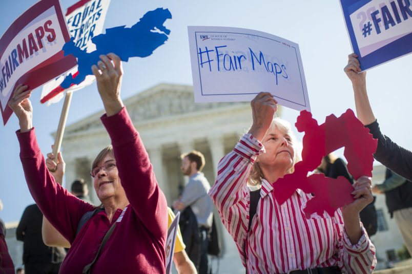 UNITED STATES - OCTOBER 03: Shirley Connuck, right, holds up a sign representing a district in Texas, as the Supreme Court hears a case on partisan gerrymandering by state legislatures on October 3, 2017. (Photo By Tom Williams/CQ Roll Call)