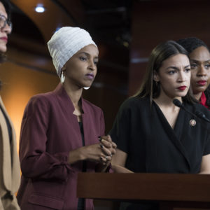 UNITED STATES - JULY 15: From left, Reps. Rashida Tlaib, D-Mich., Ilhan Omar, D-Minn., Alexandria Ocasio-Cortez, D-N.Y., and Ayanna Pressley, D-Mass., conduct a news conference in the Capitol Visitor Center responding to negative comments by President Trump that were directed the freshman House Democrats on Monday, July 15, 2019. (Photo By Tom Williams/CQ Roll Call)