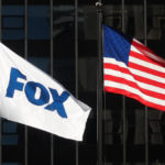 NEW YORK, NY - APRIL 24: A flag with the new logo for FOX flies outside of their corporate headquarters on 6th Avenue on April 24, 2019 in New York City. (Photo by Gary Hershorn/Getty Images)