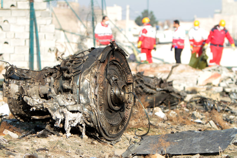 TEHRAN, IRAN - 2020/01/08: Rescue team at the crash site of a Ukrainian airliner that burst into flames shortly after take-off from Tehran on Wednesday, killing all 176 people aboard in a crash. (Photo by Mazyar Asadi/Pacific Press/LightRocket via Getty Images)
