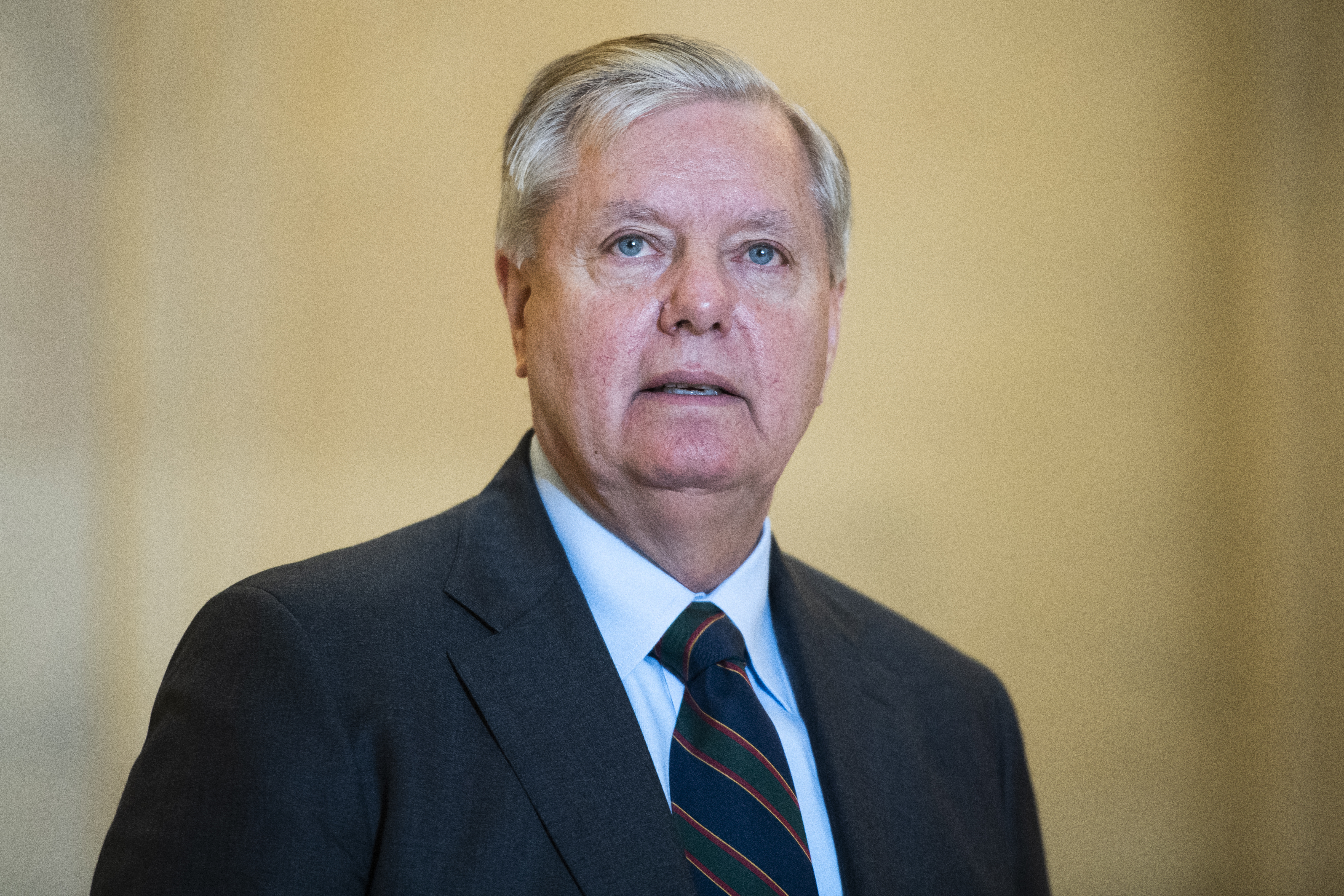 UNITED STATES - MARCH 17: Sen. Lindsey Graham, R-S.C., leaves the Senate Republican Policy luncheon in Russell Building on Tuesday, March 17, 2020. Treasury Secretary Steven Mnuchin attended to discuss the coronavirus relief package. (Photo By Tom Williams/CQ Roll Call)