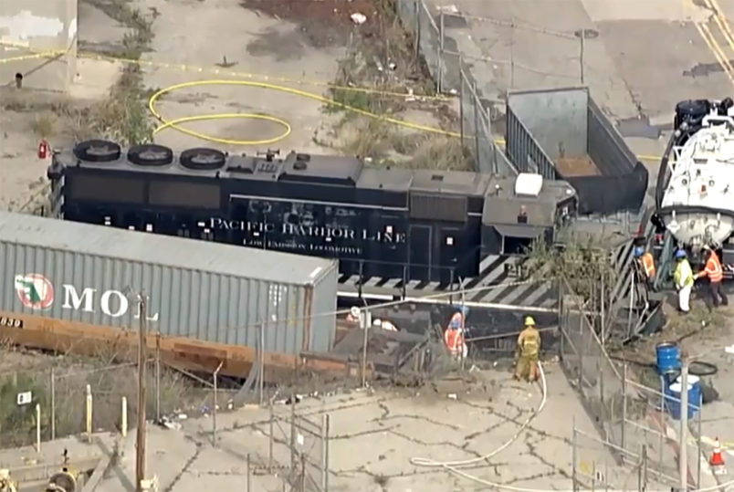 This image taken from video provided by KABC-TV shows a Pacific Harbor Line train that derailed Tuesday, March 31, 2020, at the  Port of Los Angeles after running through the end of the track and crashing through barriers, finally coming to rest about 250 yards from the docked naval ship. The train engineer intentionally drove the speeding locomotive off a track at the Port of Los Angeles because he was suspicious about the presence of a Navy hospital ship docked there amid the coronovirus crisis. (KABC-TV via AP)