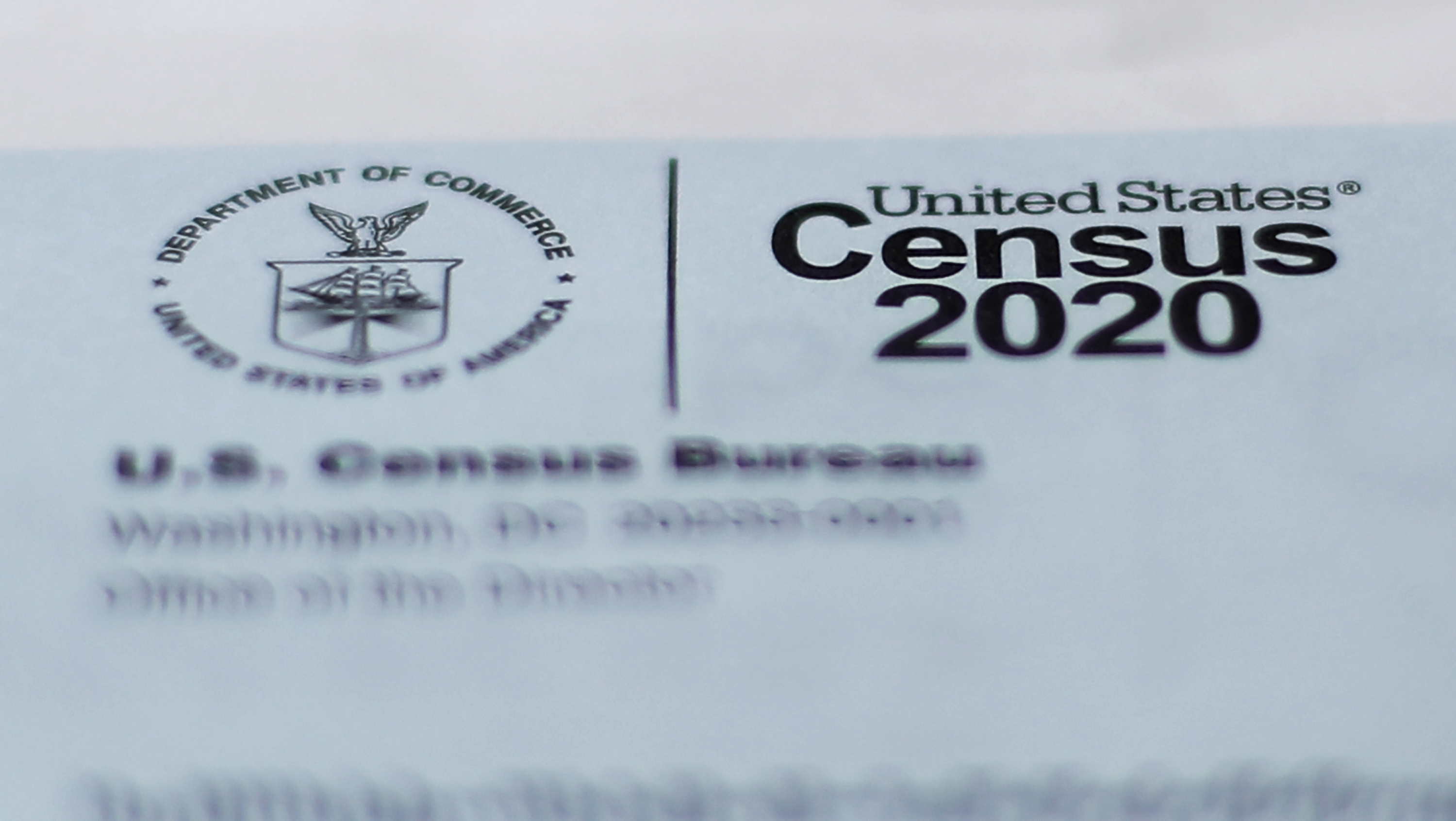 A 2020 census letter mailed to a U.S. resident, is shown in Detroit, Sunday, April 5, 2020. The Census Bureau is required by federal statute to send the president the counts that will be used to carve up congressional districts — known as apportionment — and draw state legislative districts by Dec. 31. The new coronavirus COVID-19 spread forced the U.S. Census Bureau to suspend field operations (AP Photo/Paul Sancya)