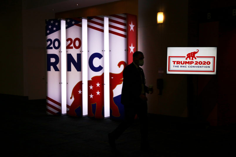 NYTRNC20An RNC sign glows outside the Charlotte Convention Center's Richardson Ballroom in Charlotte, NC where delegates gather for the roll call vote to renominate Donald J. Trump to be President of the United States and Mike Pence to be Vice President.(Travis Dove for The New York Times)