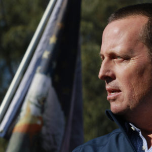 Former Director of National Intelligence Ric Grenell speaks to the news media during a press conference by members of Donald J. Trump for President, Inc., outside Clark County Election Department on November 5, 2020, in North Las Vegas. (Photo by Ronda Churchill / AFP)