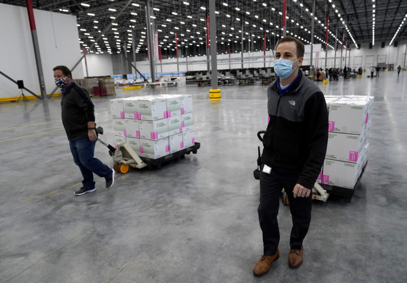 Boxes containing the Moderna COVID-19 vaccine are prepared to be shipped at the McKesson distribution center in Olive Branch, Miss., Sunday, Dec. 20. (AP Photo/Paul Sancya, Pool)