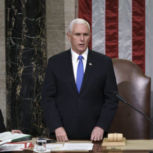 Vice President Mike Pence readS the final certification of Electoral College votes cast in November's presidential election during a joint session of Congress after working through the night, at the Capitol in Washington, Thursday, Jan. 7, 2021. Violent protesters loyal to President Donald Trump stormed the Capitol Wednesday, disrupting the process. (AP Photo/J. Scott Applewhite, Pool)