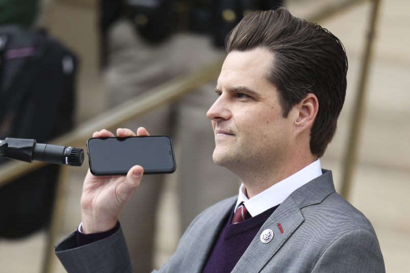 CHEYENNE, WY - JANUARY 28: Rep. Matt Gaetz (R-FL) holds a phone to the microphone as Donald Trump Jr. speaks remotely to a crowd during a rally against Rep. Liz Cheney (R-WY) on January 28, 2021 in Cheyenne, Wyoming. Gaetz and Trump Jr. added their voices to a growing effort to vote Cheney out of office after she voted in favor of impeaching Donald Trump. (Photo by Michael Ciaglo/Getty Images)