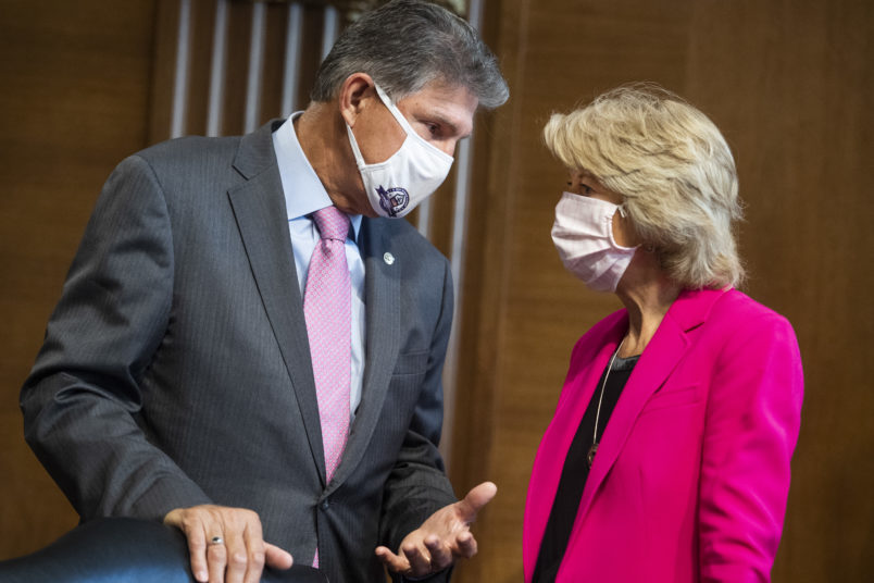 UNITED STATES - SEPTEMBER 16: Chairman Lisa Murkowski, R-Alaska, and ranking member Sen. Joe Manchin, D-W. Va., arrive for the Senate Energy and Natural Resources Committee confirmation hearing in Dirksen Building for Mark C. Christie and Allison Clements, nominees to be members of the Federal Energy Regulatory Commission, on Wednesday, September 16, 2020. (Photo By Tom Williams/CQ Roll Call)