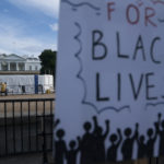 WASHINGTON D.C., June 20, 2020 -- A sign is seen during protests against racial injustice to mark Juneteenth, commemorating the end of slavery in the United States, near the White House in Washington, D.C., the United States, June 19, 2020. This year's Juneteenth comes amid nationwide demonstrations against police brutality and racism triggered by the death of George Floyd in police custody. More than 20 rallies, marches and events were scheduled for Friday in Washington, D.C., with hundreds more in over 40 states, according to the Movement for Black Lives, a coalition of U.S. groups representing the interests of black communities. (Photo by Liu Jie/Xinhua via Getty)