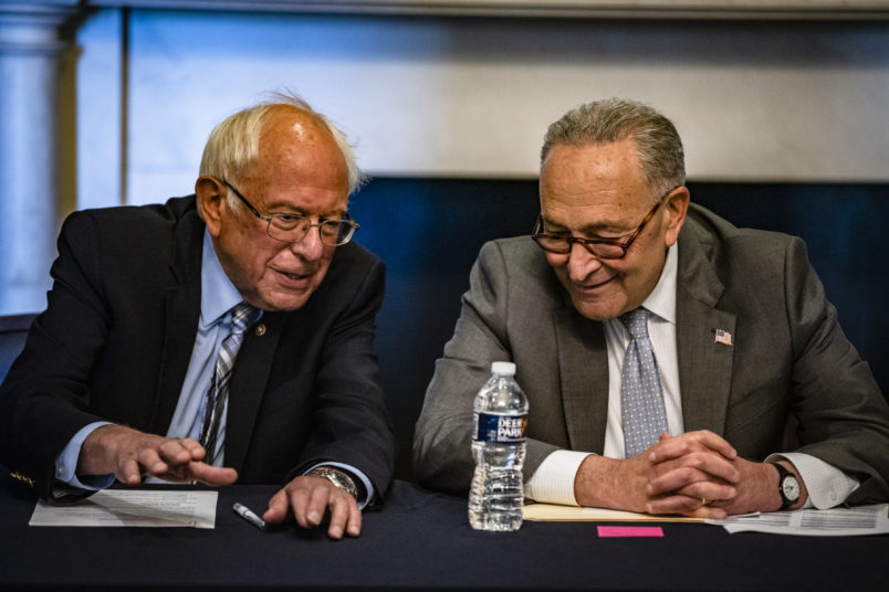 WASHINGTON, DC - JUNE 16: (R-L) U.S. Senate Majority Leader Chuck Schumer (D-NY) and Committee Chairman Bernie Sanders (D-VT) holding a meeting with Senate Budget Committee Democrats in the Mansfield Room at the U.S. Capitol building on June 16, 2021 in Washington, DC. The Majority Leader and Democrats on the Senate Budget Committee are meeting to discus how to move forward with the Biden Administrations budget proposal. (Photo by Samuel Corum/Getty Images) *** Local Caption *** Chuck Schumer; Bernie Sanders