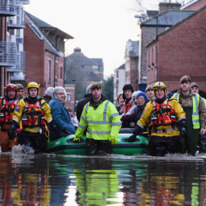 YORK, ENGLAND - DECEMBER 27: Members of Cleveland Mountain Rescue and soldiers from 2 Battalion The Duke of Lancasters Regiment assist members of the public as they are evacuated from the Queens Hotel in York city centre as the River Ouse floods on December 27, 2015 in York, England. Heavy rain over the Christmas period has caused severe flooding in parts of northern England, with homes and businesses in Yorkshire and Lancashire evacuated as water levels continue to rise in many parts. (Photo by Ian Forsyth/Getty Images)